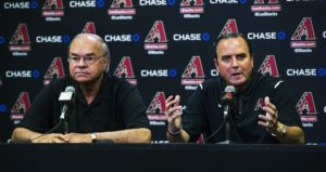 the Arizona Diamondbacks CEO Derrick Hall, right, speaks as Ken Kendrick, managing general partner of the Diamondbacks listens during a news conference in Phoenix on Monday, Oct. 3, 2016. The Diamondbacks announced in a release before the news conference that the team has fired general manager Dave Stewart and manager Chip Hale after a second consecutive losing season. (Tom Tingle/The Arizona Republic via AP)